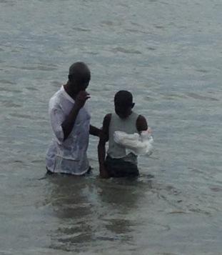 Lahai being baptized