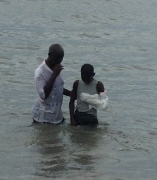 Lahai being baptized