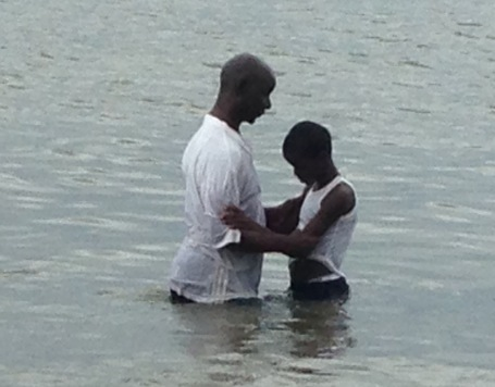 Ishmael being baptized
