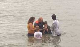 Tyler baptizing Connor
